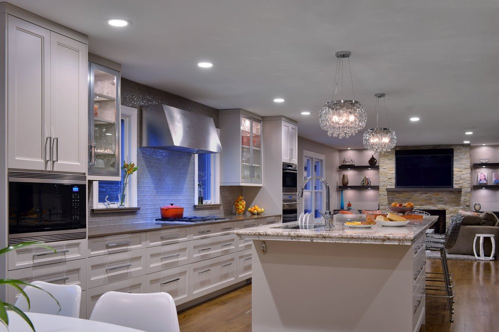 Transitional style kitchen with range and range hood