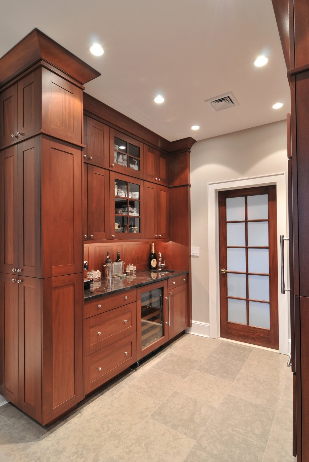 Transitional style kitchen with wine storage