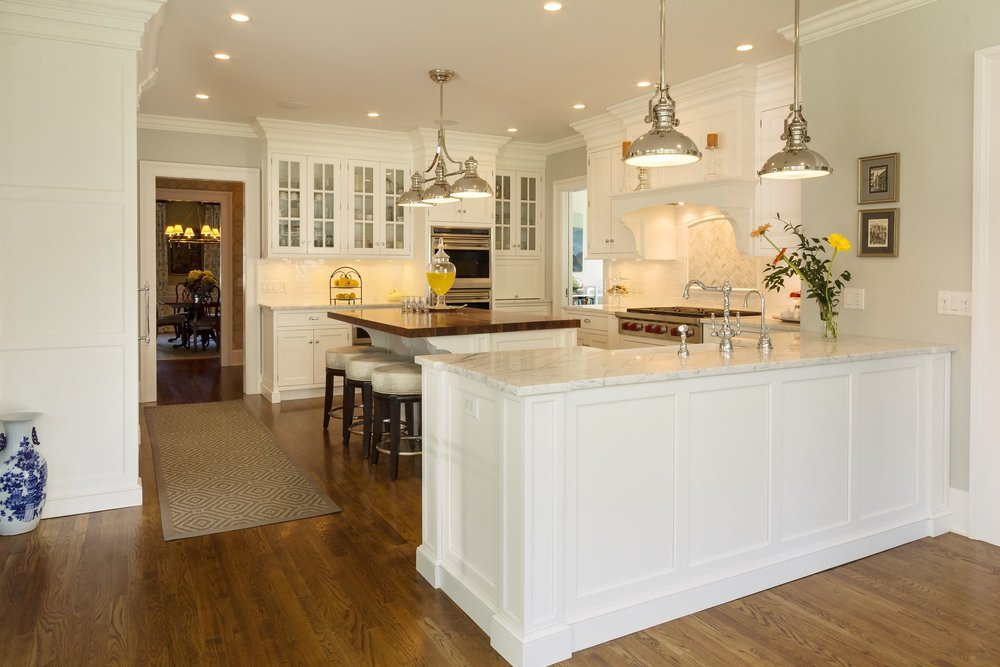 Transitional style kitchen with L'shaped counter with two pendant light fixture