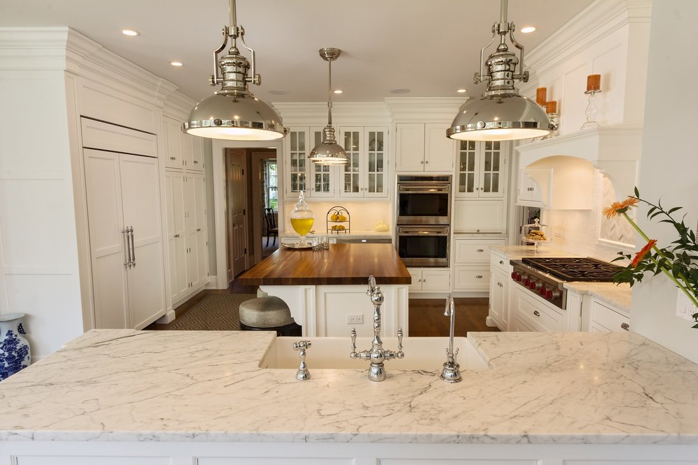 Transitional style kitchen with double hand faucet