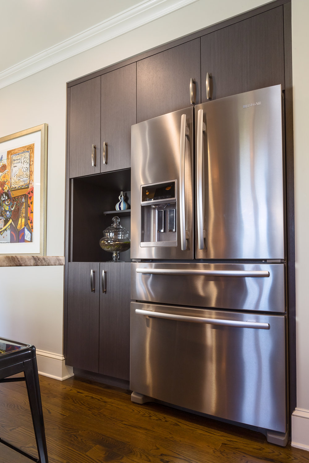Contemporary style kitchen with a stainless steel refrigerator