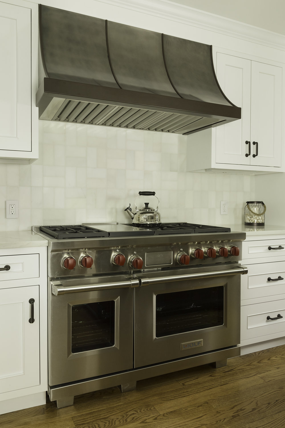 Contemporary style kitchen with stainless steel oven and range hood