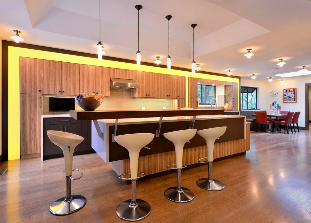 Contemporary style kitchen with counter stools