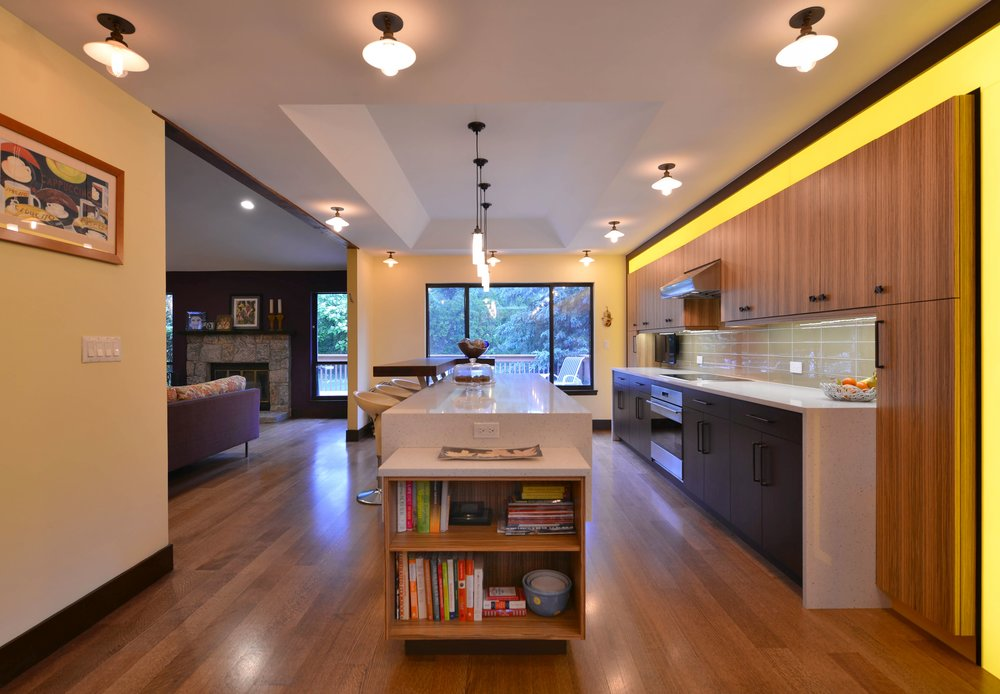 Contemporary style kitchen with extended under counter open shelves