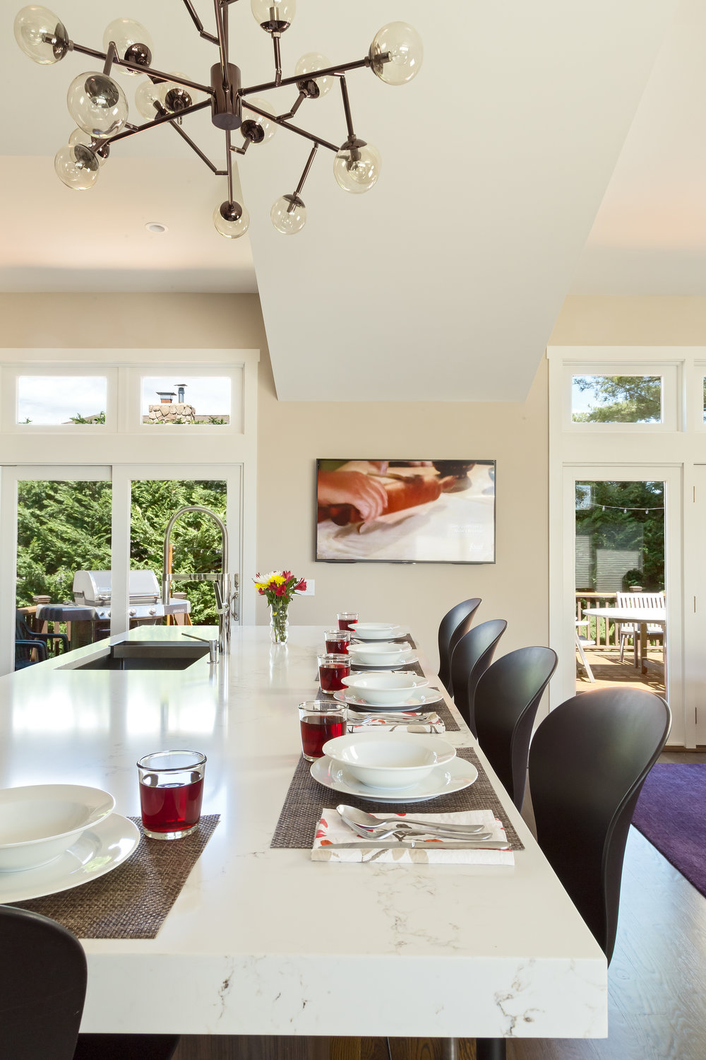 Contemporary style kitchen with long dining table