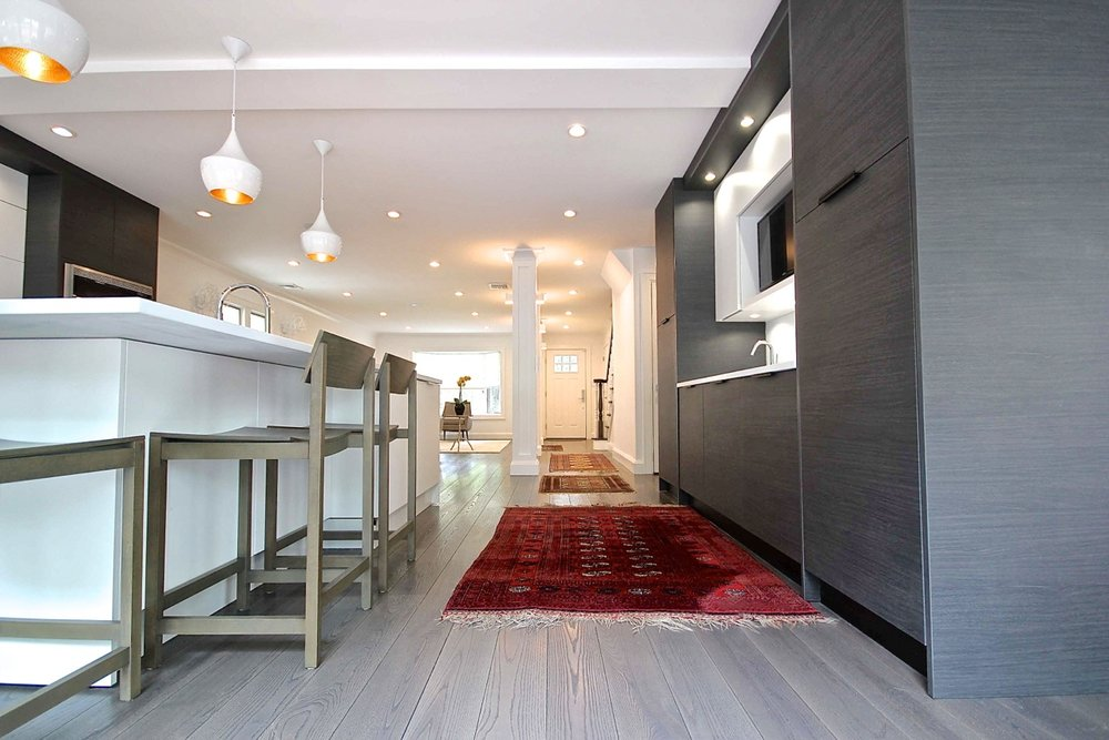 Contemporary style kitchen with carpeted floor
