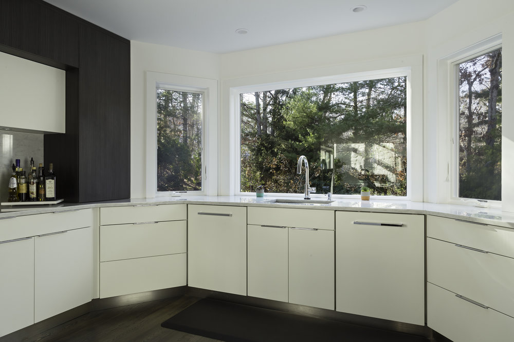 Contemporary style kitchen with wide bay window