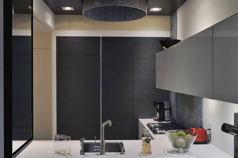 Contemporary style kitchen with upper cabinets