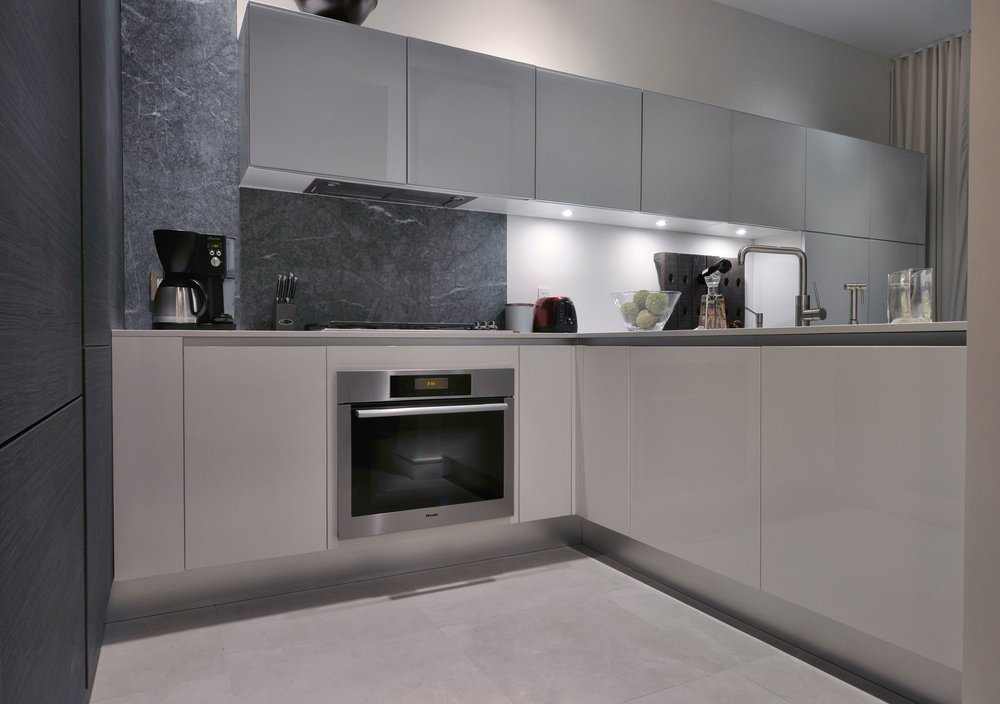 Contemporary style kitchen with range hood and range oven