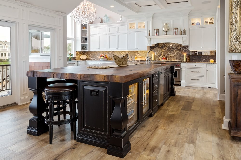 Traditional style kitchen with with wide poured concrete countertop