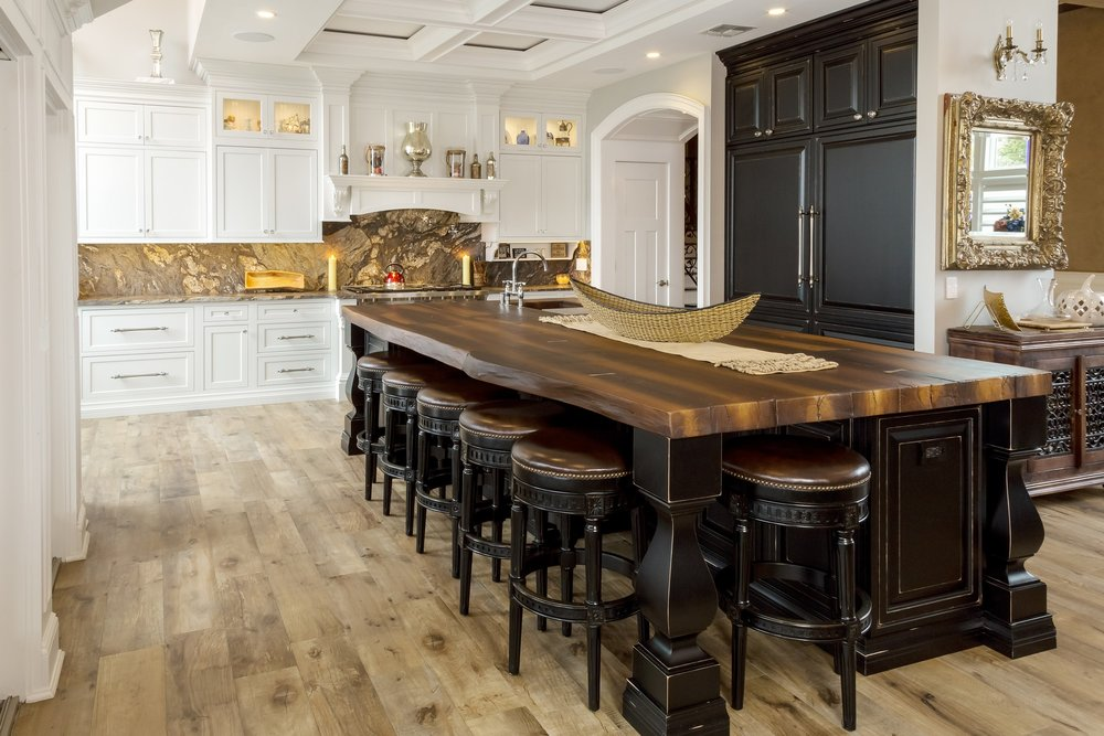 Traditional style kitchen with long breakfast table