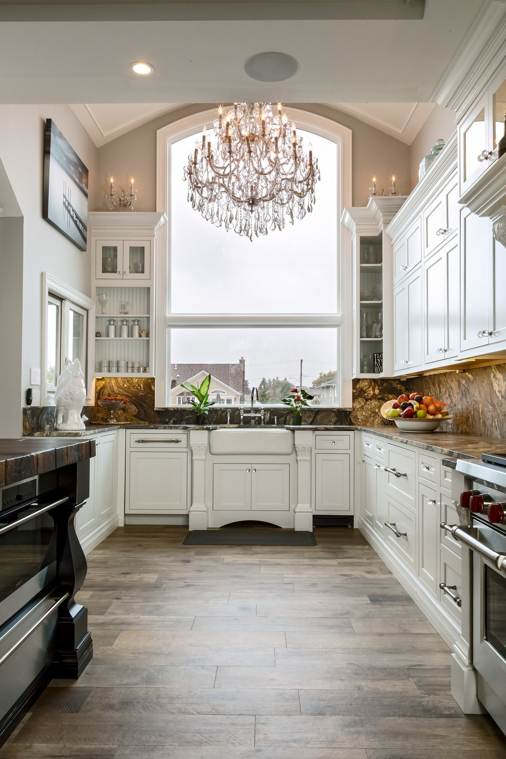 Traditional style kitchen with white cabinets and shelves