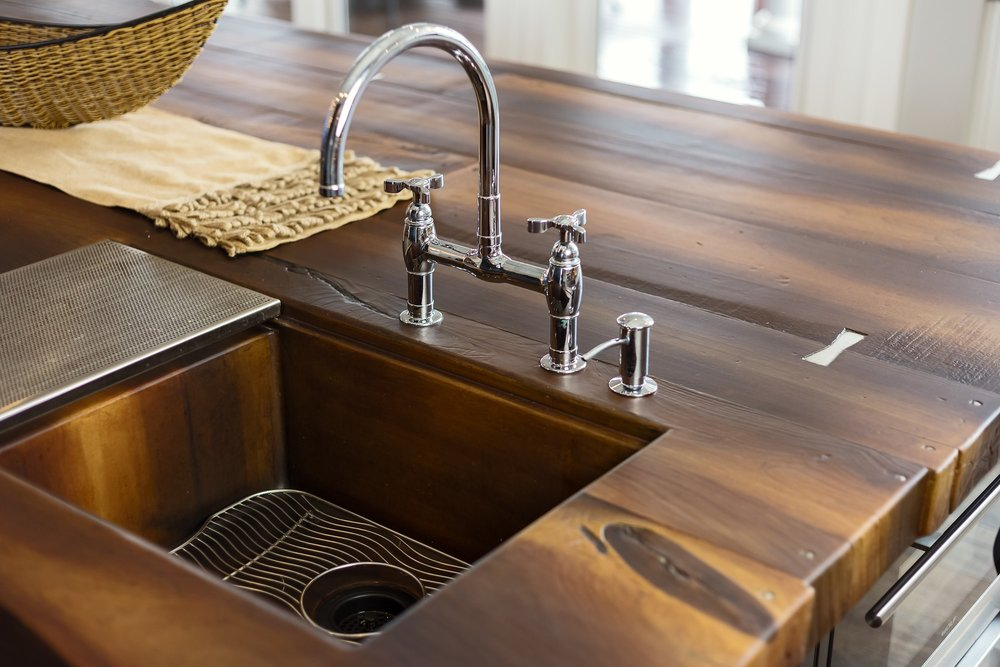 Traditional style kitchen with double handle faucets