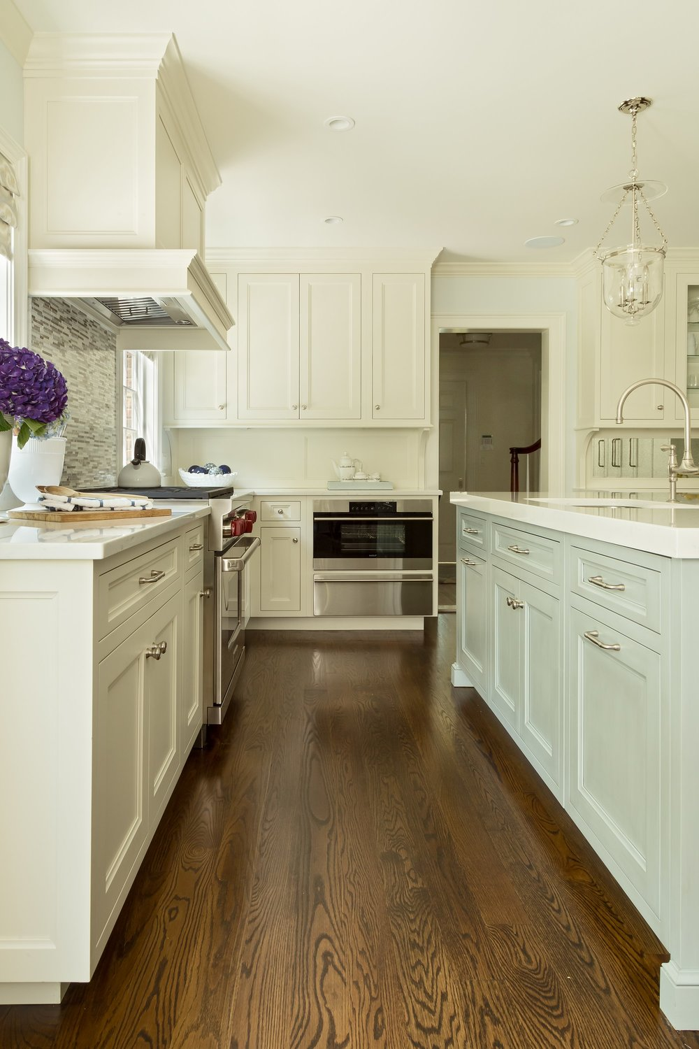 Transitional style kitchen with wooden floor