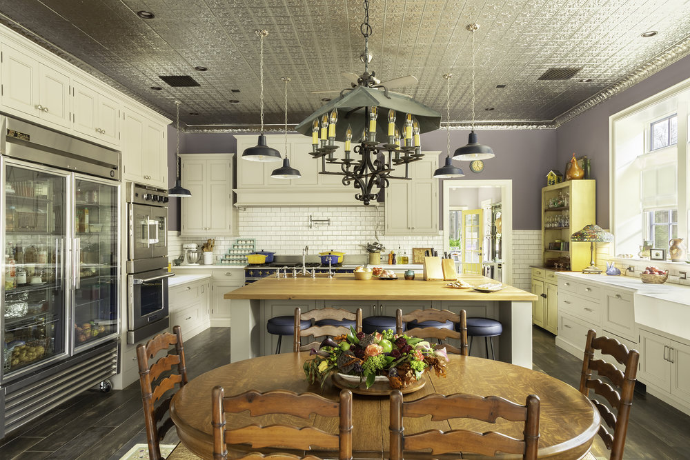 Modern Country kitchen with gray walls and yellow cabinets