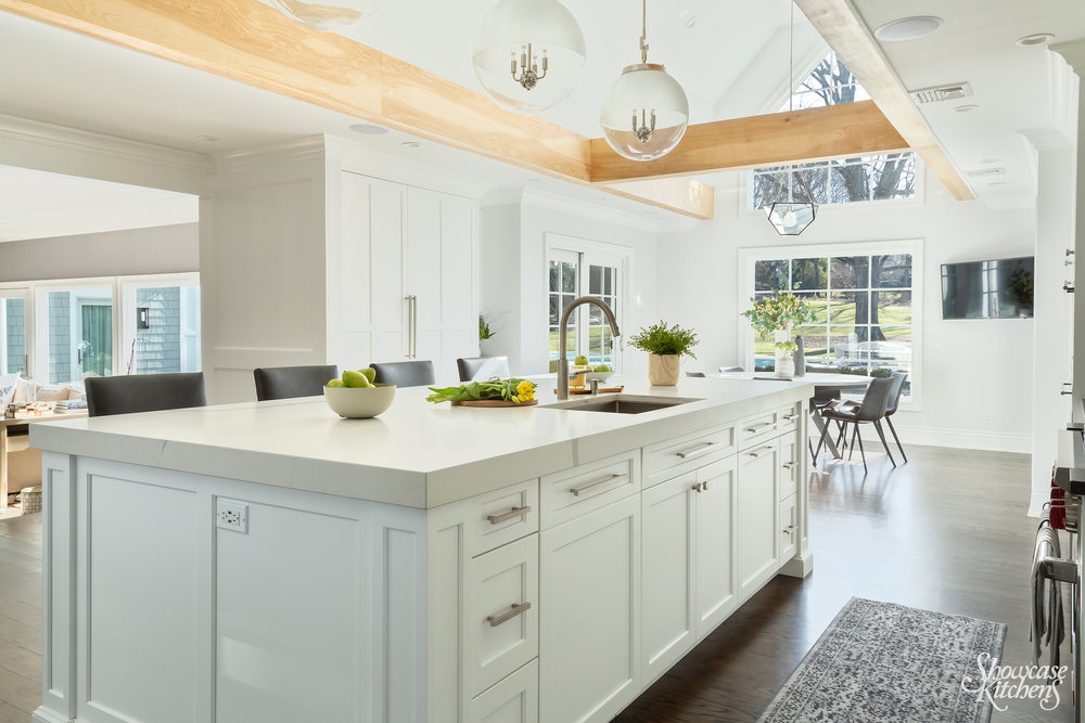 Transitional kitchen with sink on island