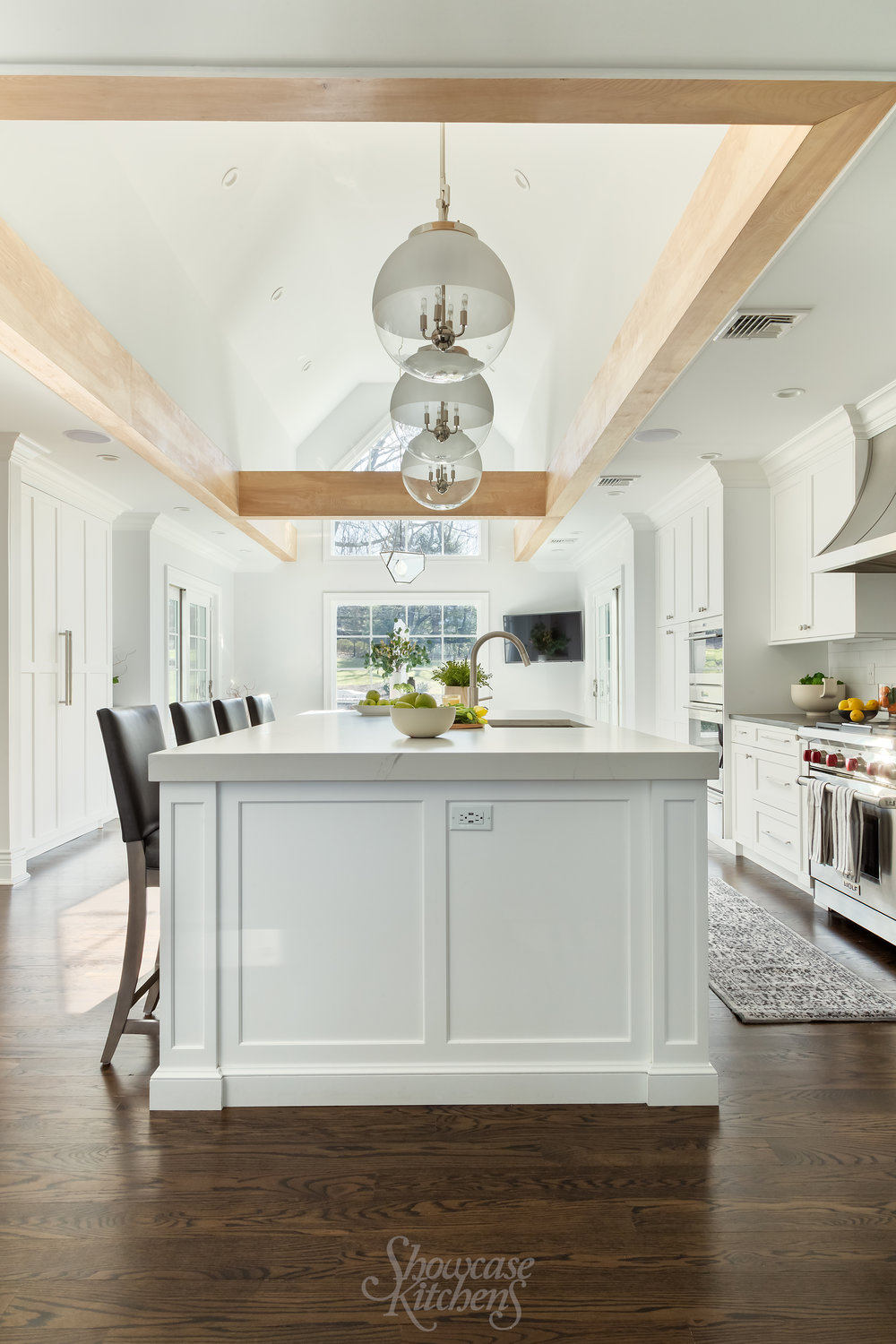 Transitional kitchen with flying beam and large center island