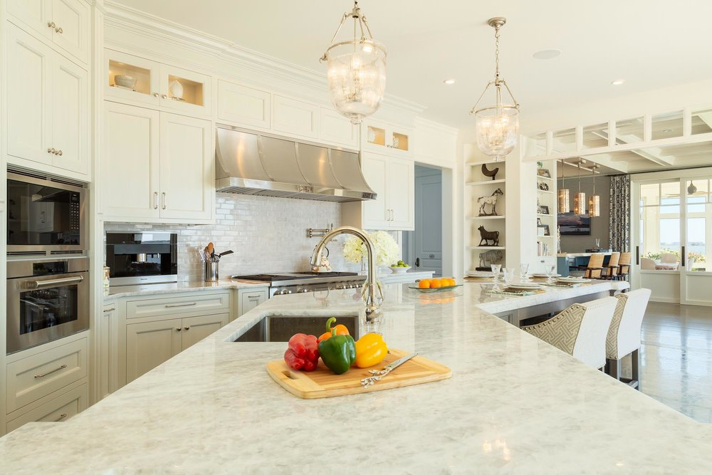 Transitional white kitchen with Quartzite countertop