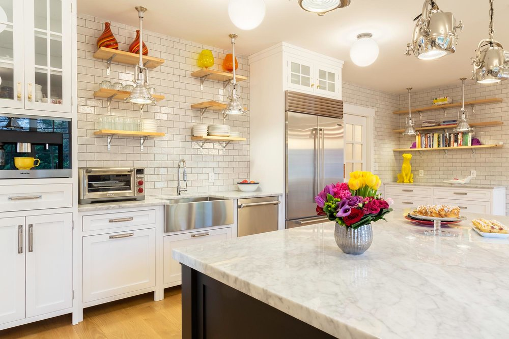 Transitional white kitchen with subway tile and open shelves