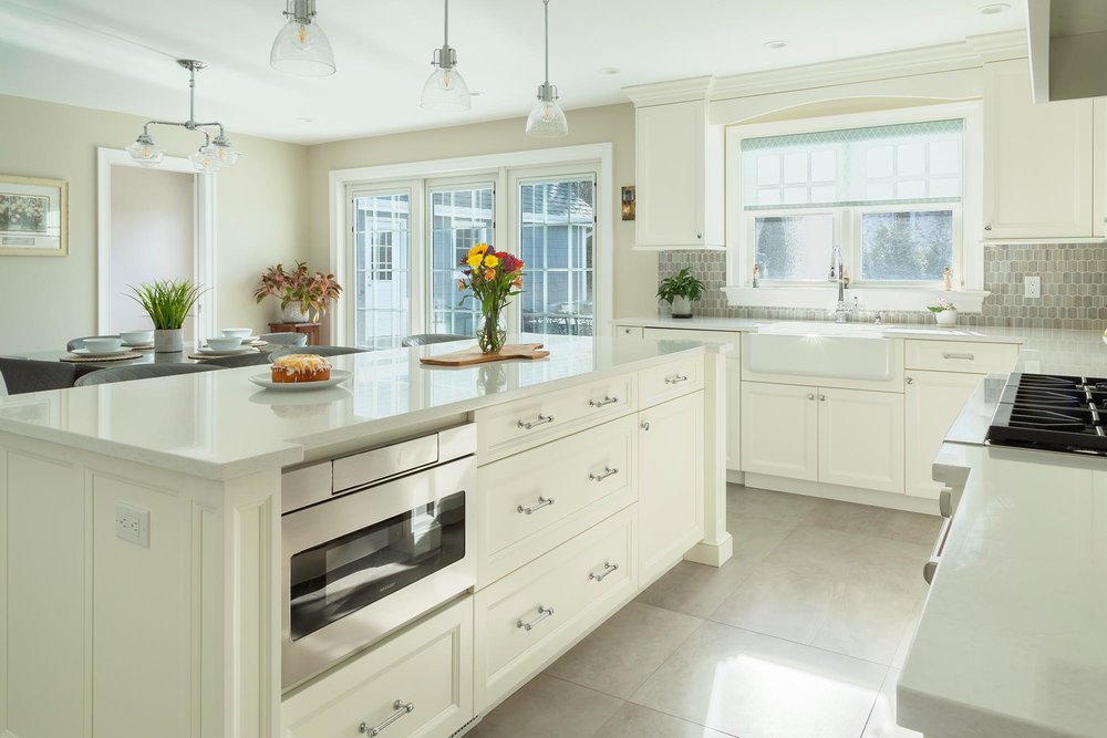 Transitional white kitchen with shaker cabinetry on center island