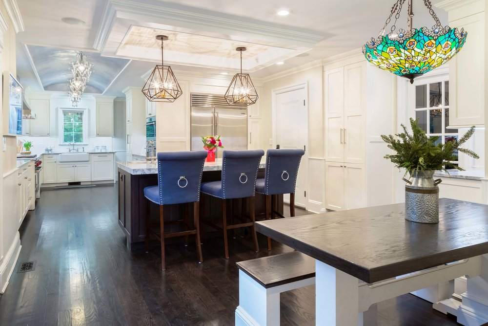 Long Island transitional kitchen has both a tray and barrel ceiling