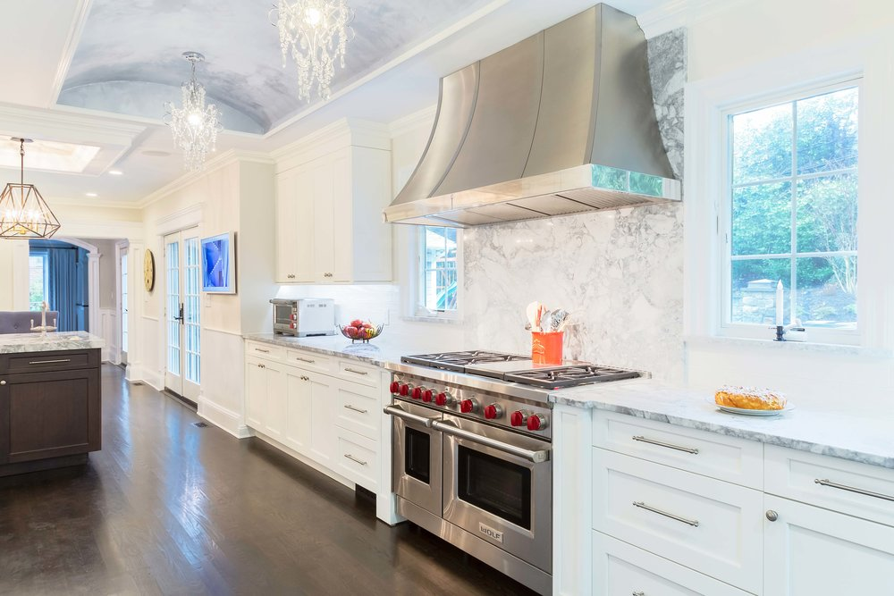 Long Island transitional kitchen with Wolf range and Wolf hood and ebony stained wood flooring