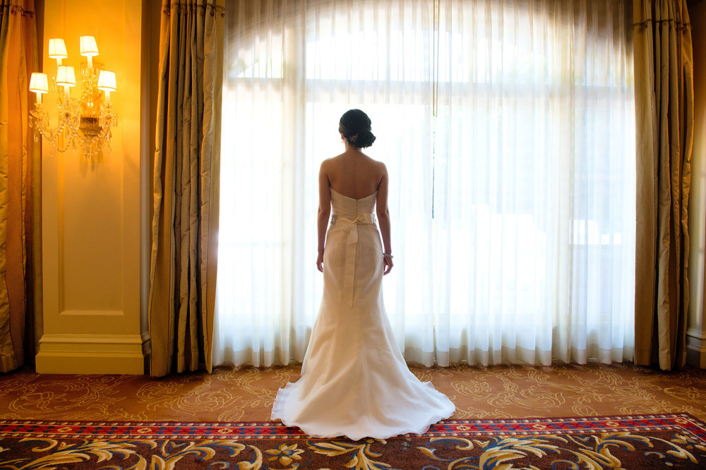 Bride facing a window at the Langham Huntington in Pasadena.