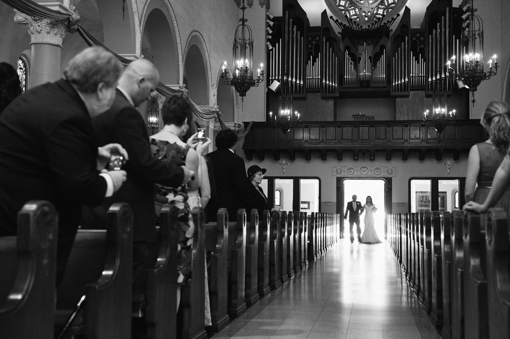 Bride and father of the bride entering church at St. Monica Catholic Church in Santa Monica.
