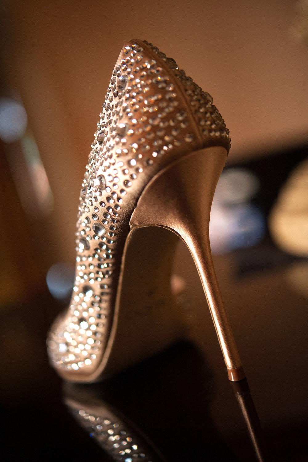 Gold and crystal high heel bride's wedding shoe.