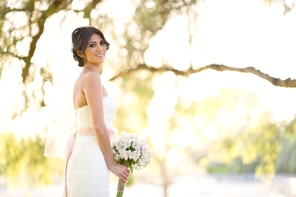 Bride with boquet with trees in the background at Ollis Ranch in Redlands.