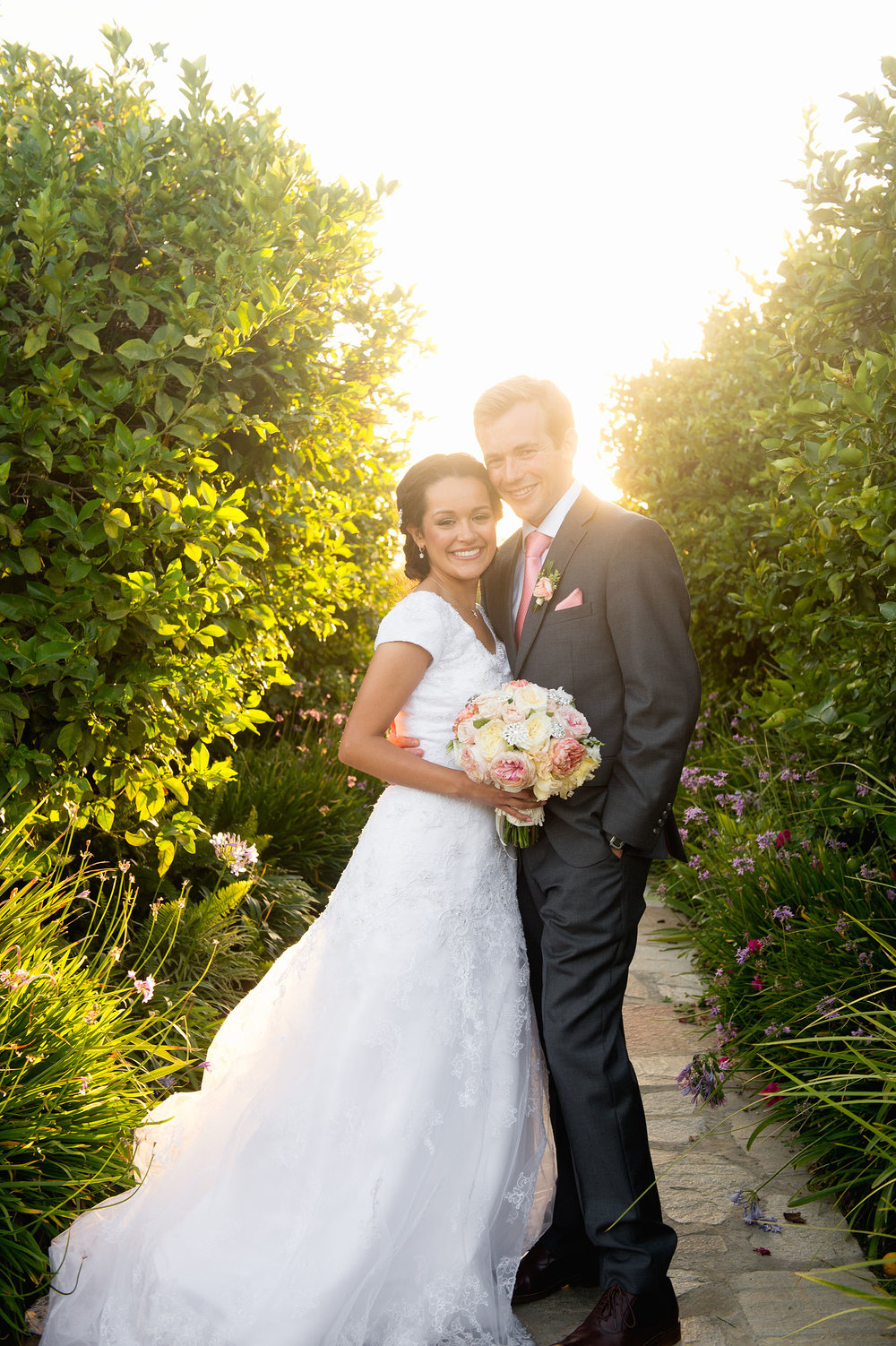 Bride and groom backlit at sunset at Gerry Ranch in Camarillo.