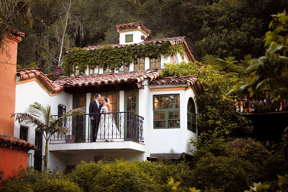 Bride and groom on balcony at Rancho Las Lomas in Silverado.
