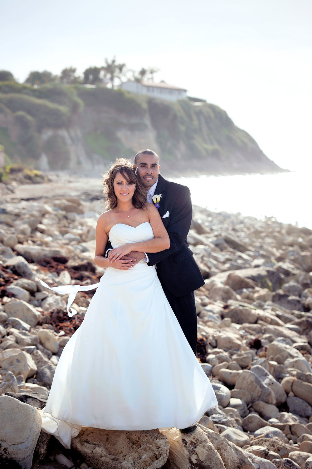 Bride and groom on the rocky beach of Malaga Cove in Rancho Palos Verdes Peninsula.
