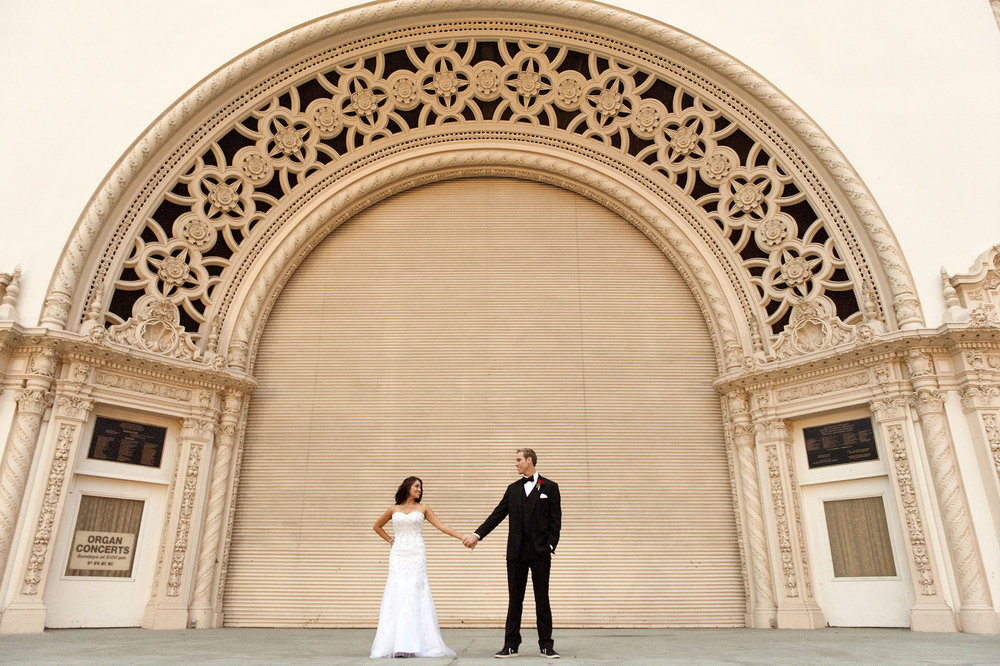 Bride and groom on the stage at Balboa Park's Spreckels Theatre in San Diego.