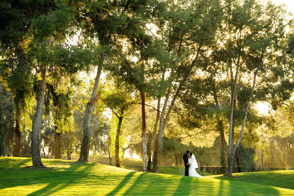 Bride and groom kissing at CrossCreek Golf Club in Temecula.