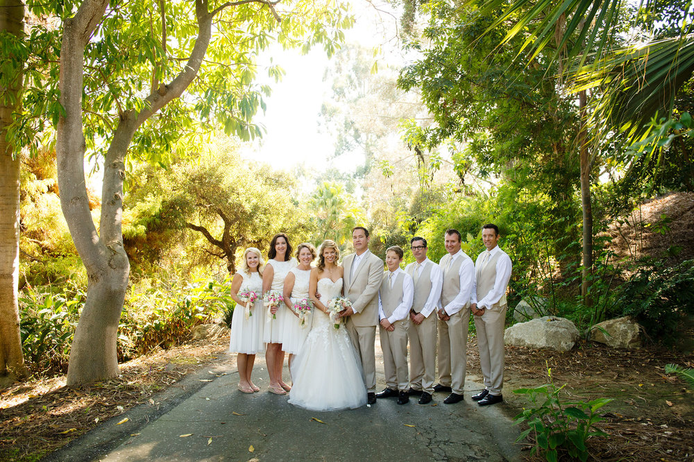 Bride and groom with wedding party at San Diego Botanic Garden.