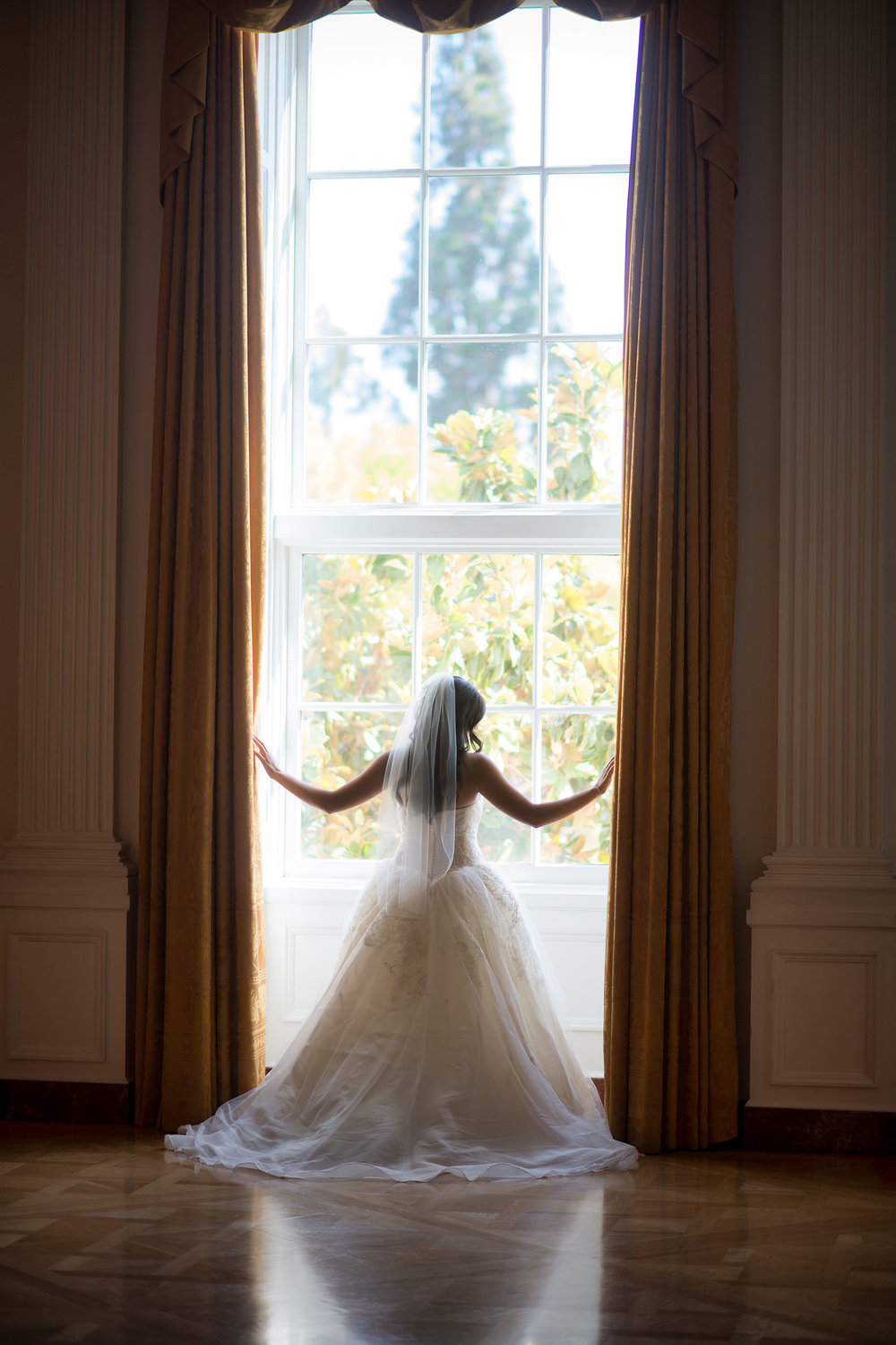 Bride backlit in window at the Richard Nixon Presidential Library & Museum in Yorba Linda.