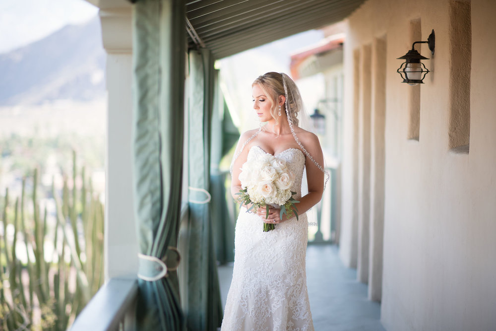 Bride with bouquet at O'Donnell House in Palm Springs.