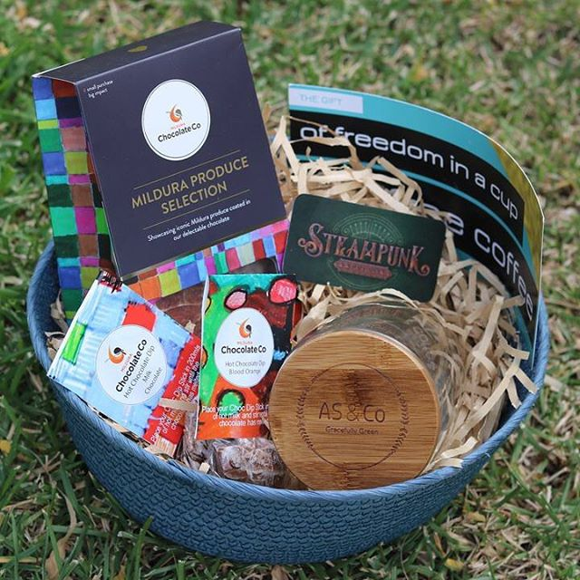 Coffee & Chocolate Lovers - Mother's Day Hamper  Does your mum LOVE coffee & chocolate? Yes?  Then why not spoil her this Mother's Day with a 'Coffee & Chocolate Lovers' hamper!  The hamper contains the following items sourced locally from Sunraysia businesses:  Stunning AS & Co Gracefully Green glass coffee cup $20 Steampunk voucher Glow coffee voucher (1 coffee) Mildura Chocolate Co. Hot Chocolate Dip - Milk Chocolate (35 grams) Mildura Chocolate Co.  Hot Chocolate Dip -Blood Orange (35 grams) Mildura Chocolate Co. Mildura Produce Selection (180 grams) All items packed in a gorgeous basket FREE personal delivery in the Mildura region Delivery options available outside of Mildura, Victoria. Please message for a quote.  R.R.P. $86.95, special price of $64.95.  Orders & payment must be received by Tuesday 7th May to secure your purchase.  Hampers numbers are limited so don't miss out on this amazing offer!!