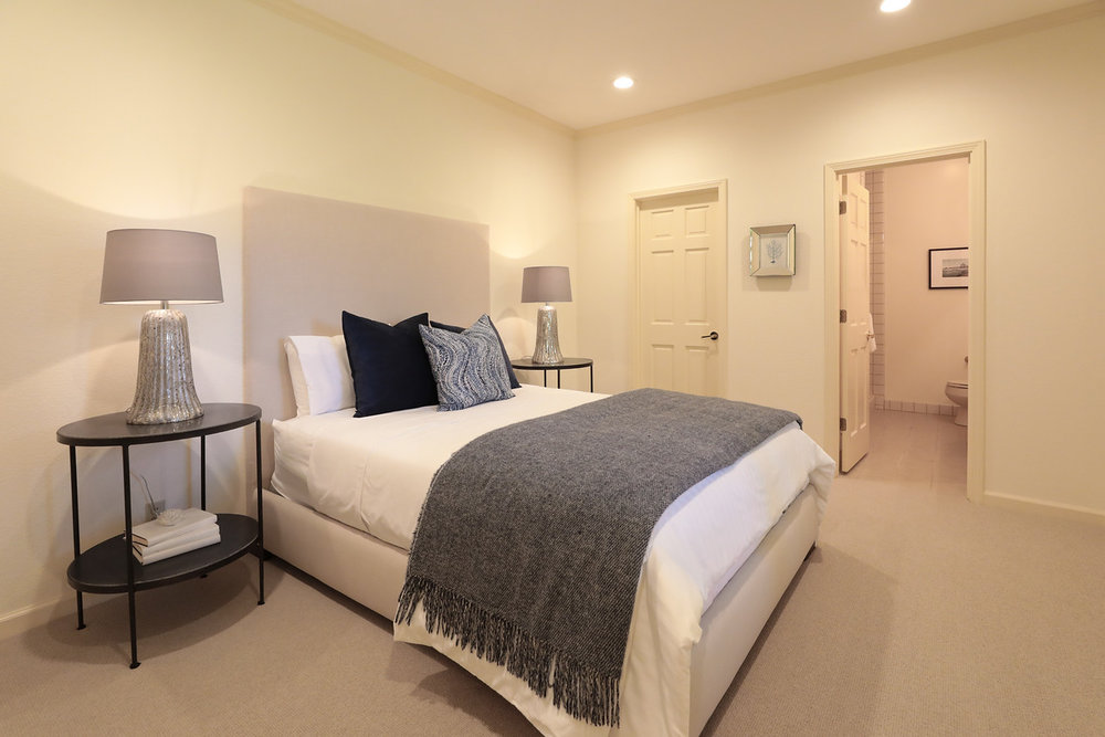 Lower level bedroom #5, used as an au-pair suite, with full bath, walk-in closet, and semi-private entrance