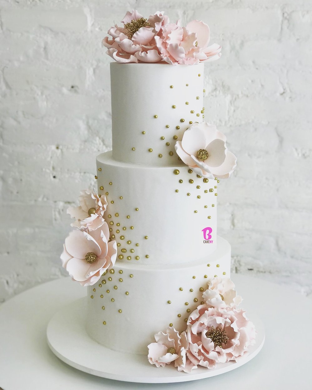 white fondant cake with sugar flowers