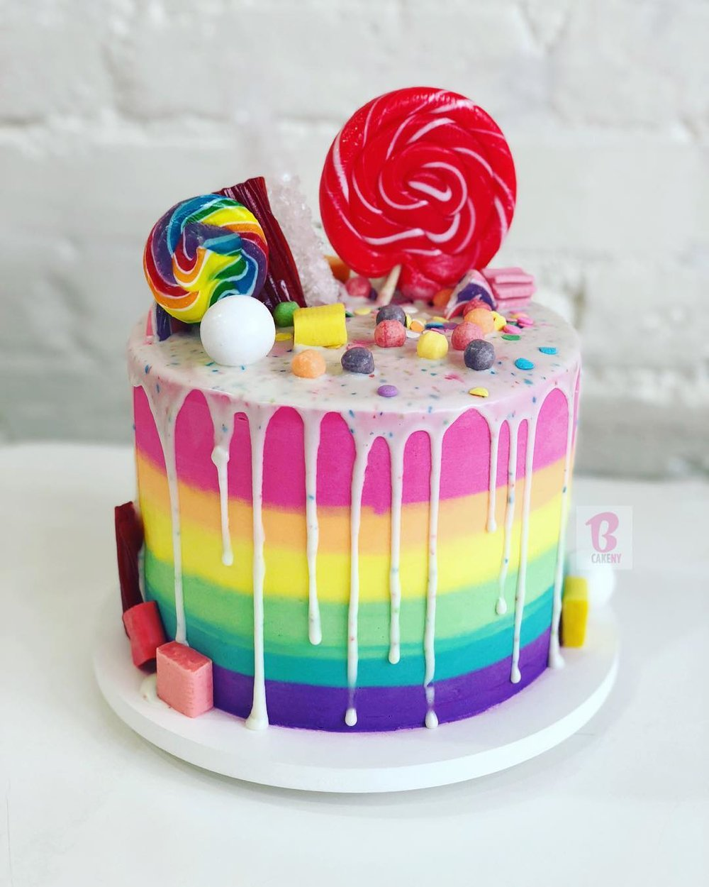 rainbow buttercream candy topped cake 1 tier