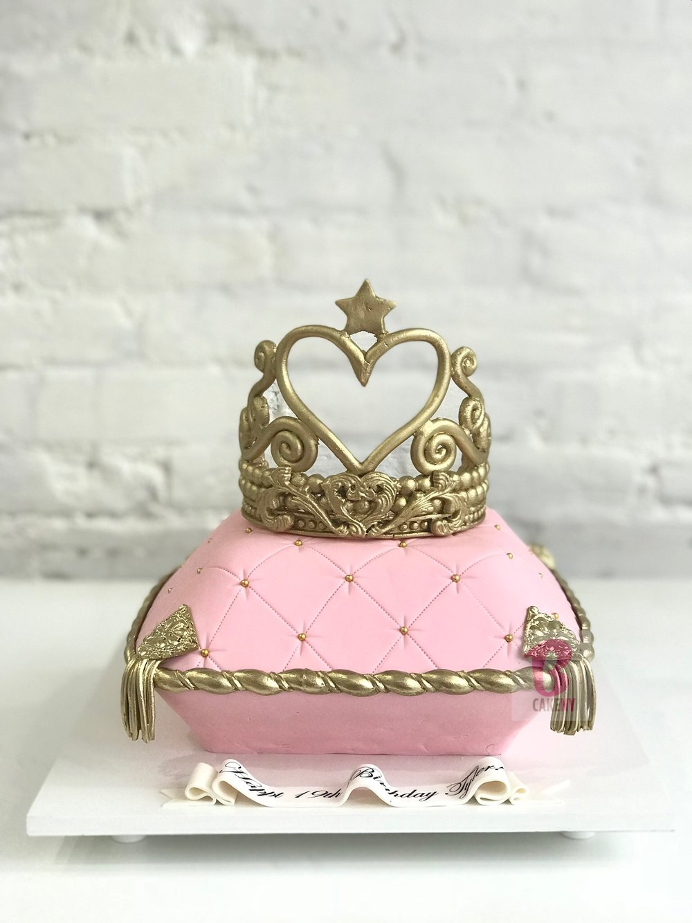 pink pillow shaped cake and sugar crown