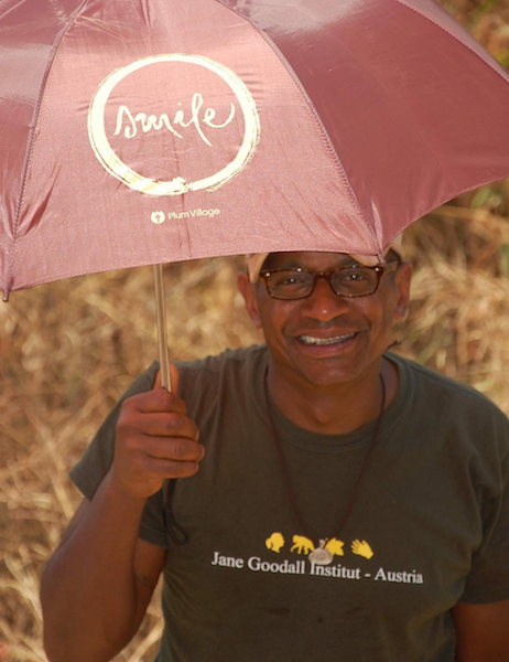 Co-Founder Gregory Kennedy in Uganda working for Dr. Jane Goodall with his Plum Village Smile Umbrella
