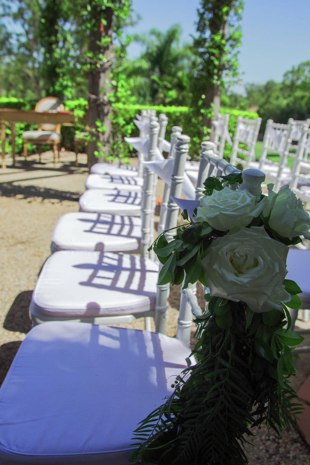 White-tiffany-chairs-wedding-flower-roses-chair-garlands-brisbane-HT-Events.jpg