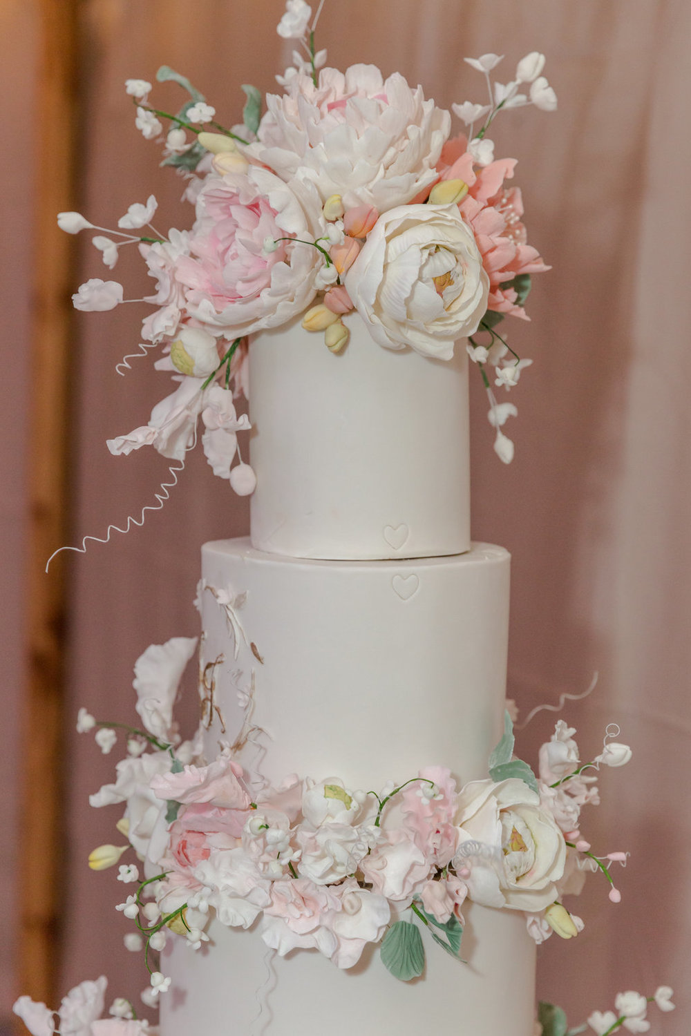 White-wedding-cake-pink-flowers-four-tier-HT-Events.jpg