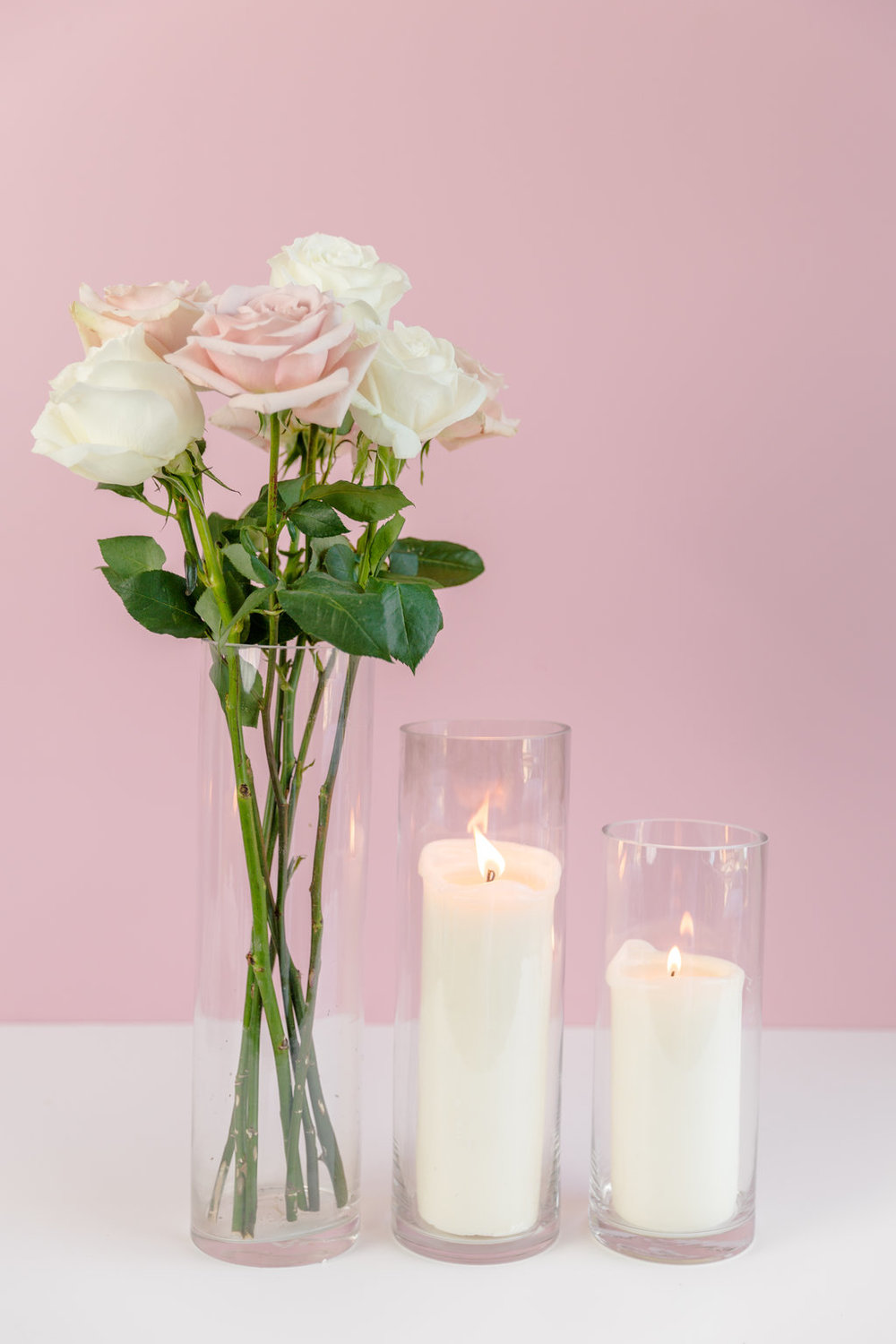 Glass Floral Pillar Vases  $5 - $12. Multiple sizes available.