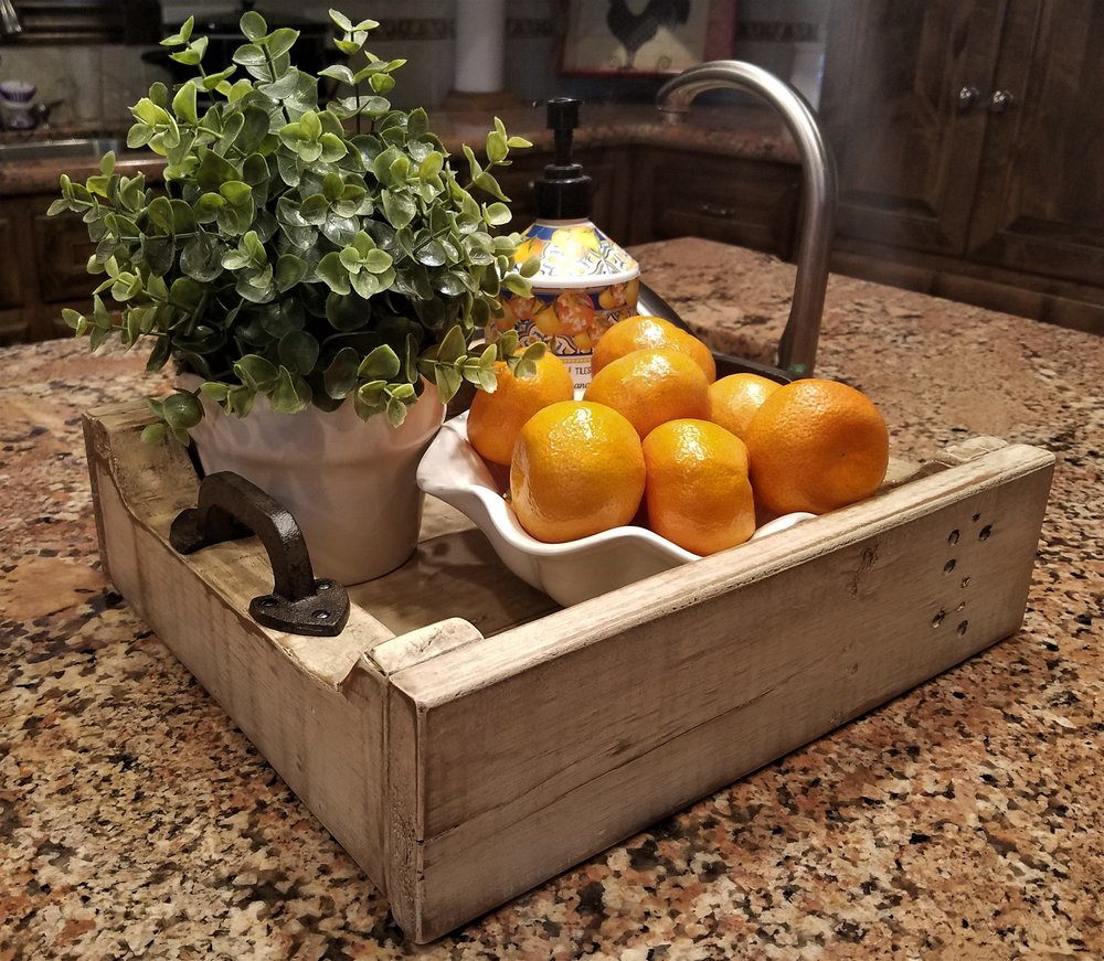 Trays can be used for keeping things together. Choose a tray color that complements your décor.  I use this tray to organize the items on my kitchen island.