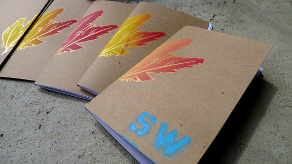 SW002 - Sugared Water's second issue features a screenprinted cover. We used red, metallic gold, or cyan acrylic stencil on these, with rainbow rolls in the feather/leaf. Colors vary from yellow to orange to red. » more
