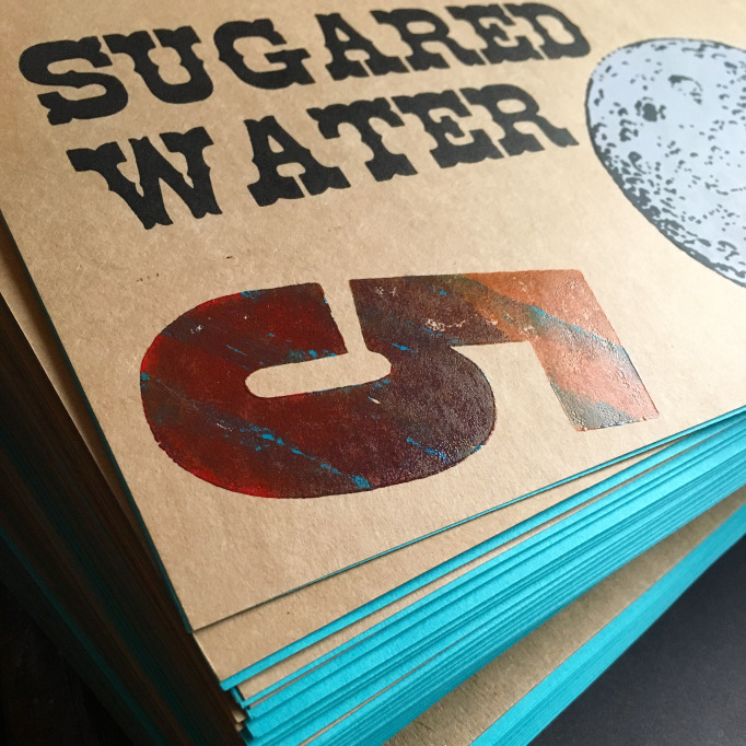 SW005 - Featuring a combination of letterpress title & screenprinted (dark side of the) moon, SW005 is our 80 page beast of an issue featuring poetry & essays. Each cover varies slightly, our numeral 5s are monoprinted with several passes of hand-rolled ink. The wood type used is vintage (thanks to Tiger Lily Press' collection), and each copy is bound by hand and numbered. Blue end papers. » more